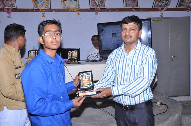 Gourav Verma ( 10th Topper of village - 2013 ) honour by K.K Singh ( Branch Manager SBBJ Lalgarh Jattan )